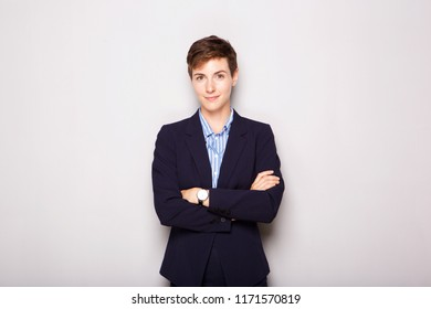 Portrait of professional young business woman against white background