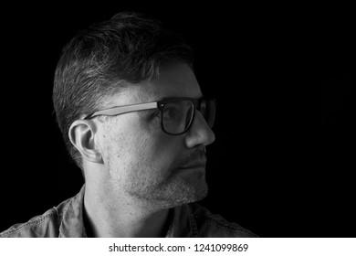 portrait of a profile man on blalck