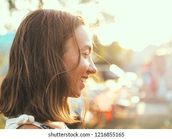 Portrait profile of a woman in the rays of the setting sun