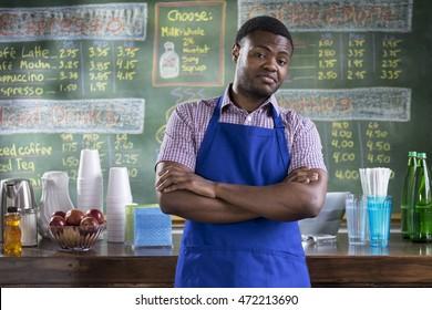 Portrait of a proud cafe worker, wide shot