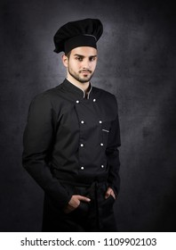 Portrait of a proud chef, gray background
