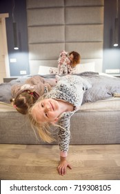 Portrait of a proud loving mother and happy little girl daughter sisters. Children wearing pajama. Laughing and having fun playing at home. Concept of love and happiness happy family.Family portrait.