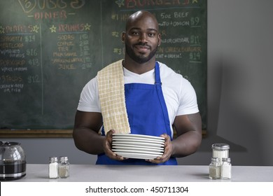 Portrait of a proud restaurant worker