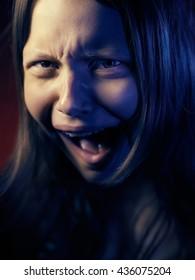 Portrait of a psycho teen girl.