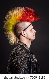Portrait of punk rocker with Mohawk on a black background.