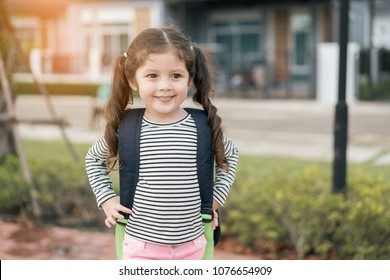 Portrait of pupil kid girl preschool with school bag kindergarten education concept.