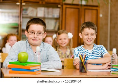 Portrait of pupils looking at camera in classroom