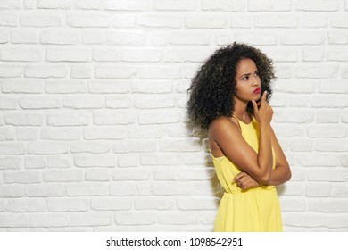 Portrait of puzzled woman having doubts, doubtful black girl thinking. Copy space