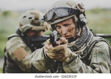 Portrait of a ranger in the battlefield with a pistol