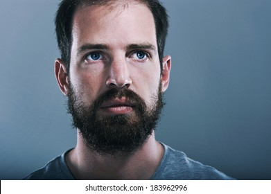 Portrait of real hipster man with full beard