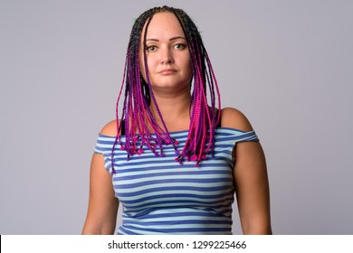 Portrait of rebellious woman with dreadlocks looking at camera