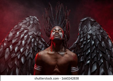 portrait of reckless dark angel with strong muscles, having athletic body, african man in the flesh of dark angel illustrate falling from heaven, angel wants to give people the right decision
