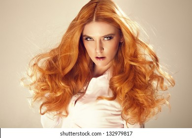 Portrait of red hair beautiful woman, looking at camera.