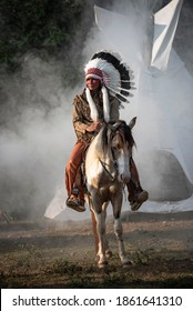 Portrait of the Red Indian riding a horse and feathered headdress with weapon