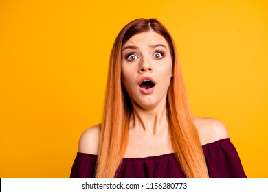 Portrait of red straight-haired attractive cute nice scared young girl with opened mouth. Isolated over bright vivid yellow background