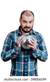 Portrait of a red-bearded, balding male brutal. White isolated background. A man in a blue plaid shirt. Holding disco ball in his hands and looking at the camera