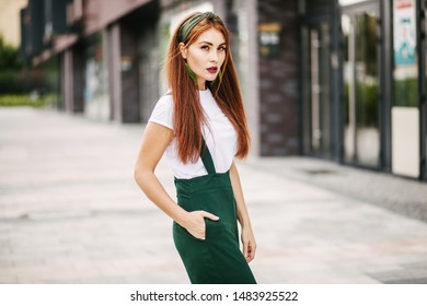 Portrait of a red-haired girl in the city