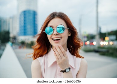 portrait, red-haired girl in glasses