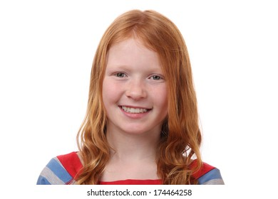 Portrait of a red-haired young girl on white background