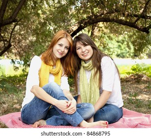 Portrait of redhead and brunette girls at outdoor. Autumn.