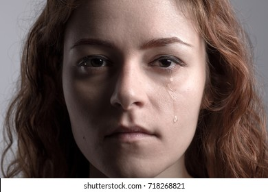 Portrait of a Redhead Crying Woman