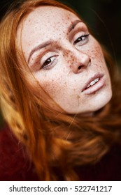 Portrait redhead woman with freckles