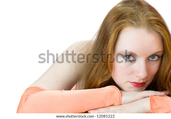 Portrait of redhead woman with orange gloves isolated on white
