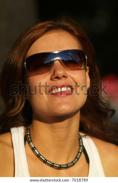 Portrait of redheaded woman with sunglasses