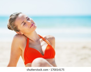 Portrait of relaxed young woman on beach