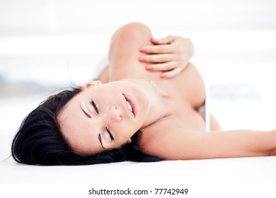 Portrait of relaxing sexy woman on white