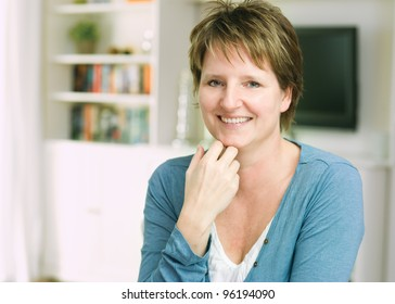 Portrait of relaxing woman sitting at home