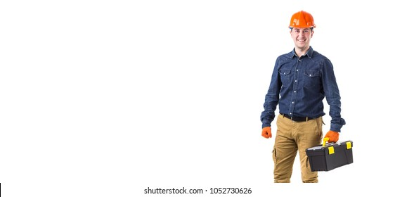 Portrait of repairman (builder) in helmet and with tool box in hands isolated on white background. Copy space