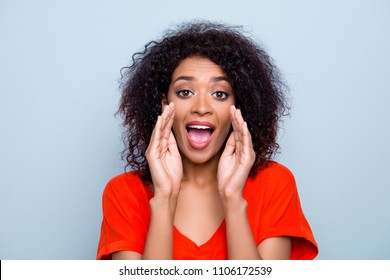 Portrait of responsible modern woman in vivid outfit holding two palms near wide open mouth yelling important news interesting information isolated on grey background