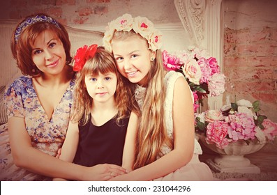 Portrait retro of family: woman with two daughters