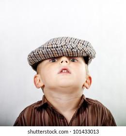 A portrait  retro. A little boy looks straight at lens.