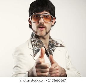 Portrait of a retro man in a 1970s leisure suit and sunglasses