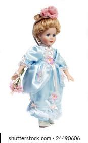 Portrait of retro porcelain doll face with blue dress