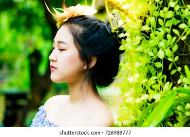 Portrait retro or vintage charming young girl: A beautiful girl up do hair style and put the beautiful hair clip on her hair. She looks so attractive and beautiful. She looks younger than her age.