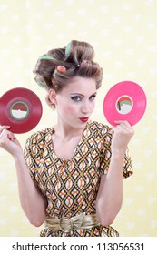 Portrait of retro woman holding LP records.