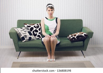 Portrait of retro woman sitting on couch