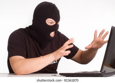 portrait of a robber with a laptop