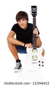 Portrait of rock artist posing in studio with guitar
