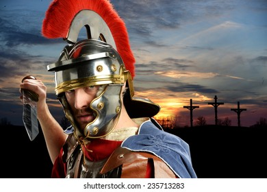 Portrait of Roman soldier brandishing sword with Calvary and crosses at sunset