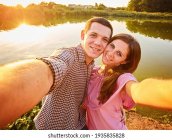 Portrait of Romantic couple embracing in love looking at camera. Handsome man and pretty woman in sunglasses smiling happy.