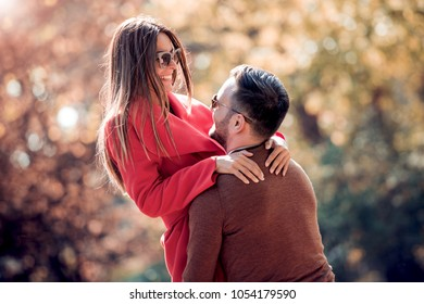 Portrait of romantic couple in love hugging on the street.Falling in love.