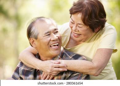 Portrait romantic senior Asian couple outdoors