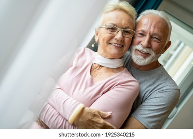 Portrait of romantic senior man with his wife at home,enjoying together.