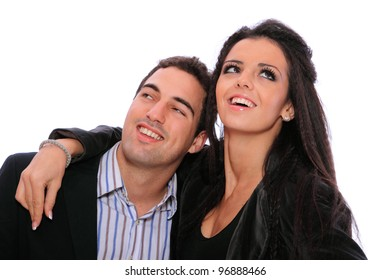Portrait of a romantic young couple standing together over white background