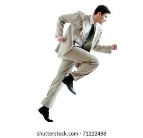 Portrait of running businessman against white background