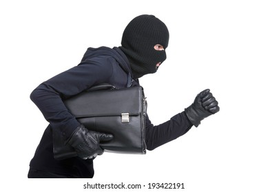Portrait of running male burglar with a handbag. Isolated on white background